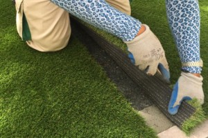 trimming edges of a fake lawn