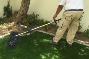 Finishing touches to artificial grass installation
